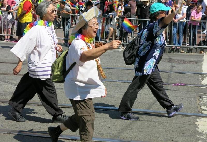 Three women march in San Francisco's Pride parade.